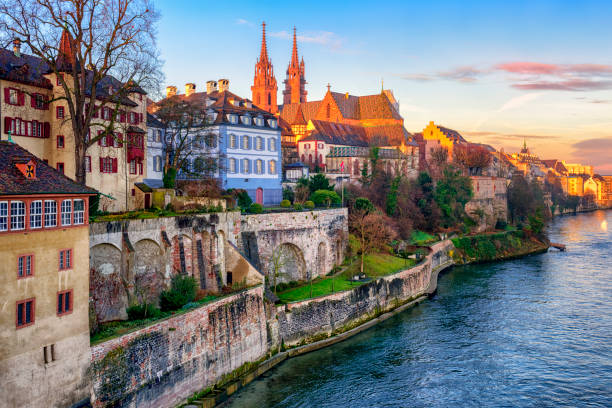Old town of Basel with Munster cathedral, Switzerland Old town of Basel with red stone Munster cathedral on the Rhine river, Switzerland switzerland stock pictures, royalty-free photos & images