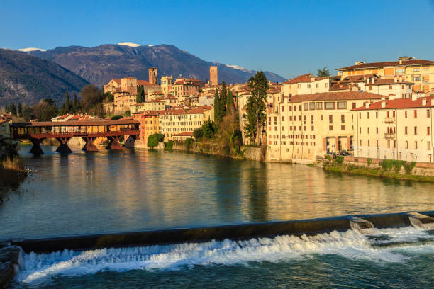 Old town of Bassano del Grappa along the river Brenta with the famous Ponte degli Alpini. Province of Vicenza, Italy - foto stock