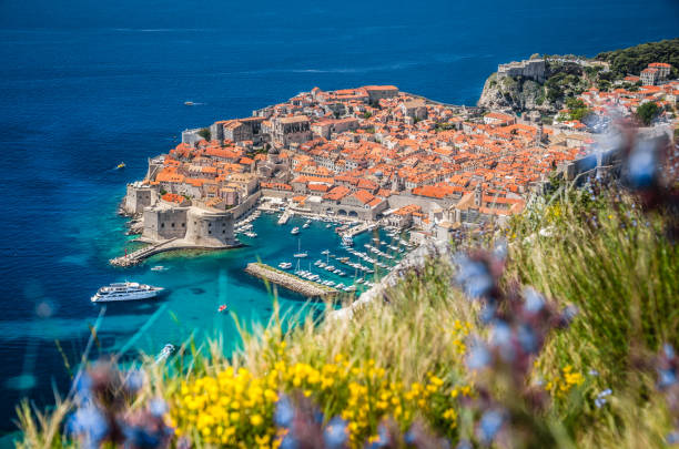 Old town of Dubrovnik in summer, Dalmatia, Croatia Panoramic aerial view of the historic town of Dubrovnik, one of the most famous tourist destinations in the Mediterranean Sea, from Srt mountain on a beautiful sunny day in summer, Dalmatia, Croatia mediterranean sea stock pictures, royalty-free photos & images