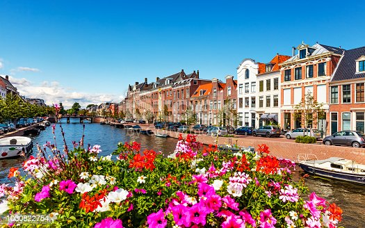 Scenic summer view of the Old Town architecture and Spaarne canal embankment in Haarlem, Netherlands