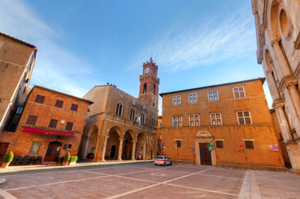 Old town of Pienza in Tuscany, Italy. Historic city center. Old town of Pienza in Tuscany, Italy. Historic city center. Blue morning sky pienza stock pictures, royalty-free photos & images