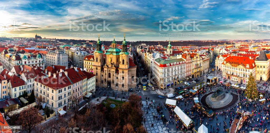 Old Town of Prague, Czech Republic. View on Tyn Church and Jan Hus Memorial on the square as seen from Old Town City Hall. Blue sunny sky stock photo