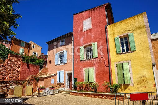 Traditional colorful houses in the Old Town of Roussillon, Provence, France