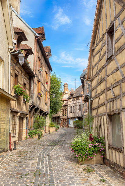 Old town of Troyes, France Alley with half-Timbered houses at the historic old town of Troyes, Champagne-Ardenne, France grand est stock pictures, royalty-free photos & images