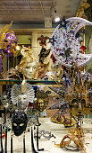 Venice, Italy - September 28, 2015 : Old town of Venice. A showcase of a souvenir shop with masks on a narrow street away from Piazza San Marco in Venice, Italy