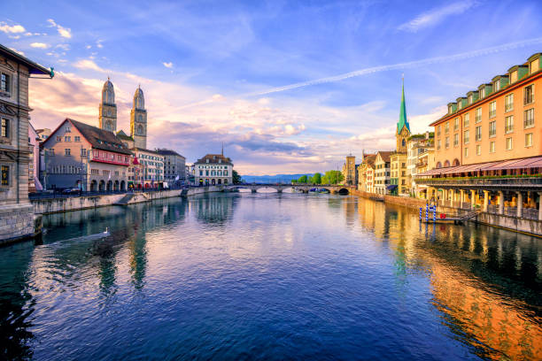 Old town of Zurich on sunrise, Switzerland Panoramic view of the old town of Zurich and Limmat river on sunrise, Switzerland fraumunster stock pictures, royalty-free photos & images