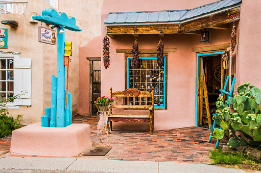 Old Town Plaza At Hidden Patio With San Pasquals Shop And Decorative Sidewalk With Brick Paths Flowers Dried Chiles And Gardens Stock Photo - Download Image Now