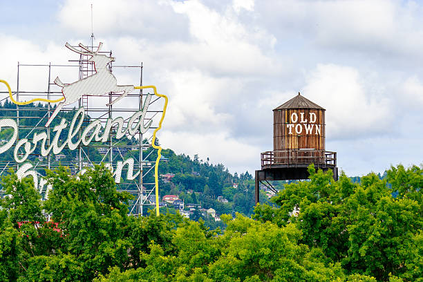 Old Town Portland Oregon Portland, Oregon, United States - June 11, 2016: The White Stag sign, a former advertising sign, greets those traveling into Old Town on the Burnside Bridge. old town stock pictures, royalty-free photos & images