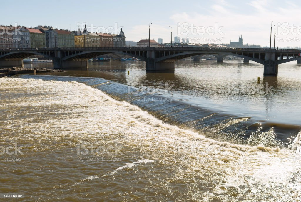 Old Town Prague Czech stone bridge over the turbulent river threshold on the Vltava stock photo