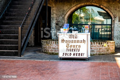Savannah, USA - May 11, 2018: Old town River street in Georgia southern city with Savannah tours ticket office kiosk stand with nobody in summer