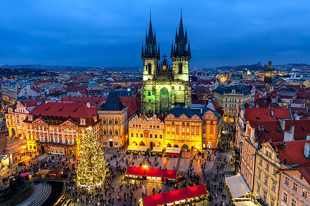 Old Town Square in Prague at Christmas time. Prague, Czech Republic - December 10, 2015: View from above on traditional market at Old Town Square illuminated and decorated for Christmas holidays in Prague  -  popular tourist destination, capital of Czech Republic and fifth most visited European city. tyn church stock pictures, royalty-free photos & images