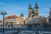 Prague, Czech Republic - January 30, 2019: Staroměstské náměstí. People walking on old town square in Prague on a sunny day, with Church of Our Lady before Tyn in the background.