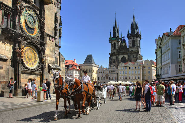 Old Town Square in Prague. Prague: Carriage and tourists on Old Town Square (Stare Mesto) in front of Tyn Church and famous Astronomical Clock july 17, 2009 in Prague, Czech Republic. tyn church stock pictures, royalty-free photos & images