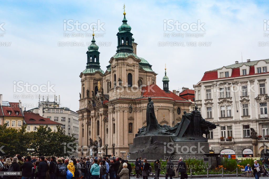 Old Town Square near Jan Hus Memorial and St. Nicholas Church in Prague stock photo