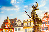 istock Old town square Romerberg with Justitia statue in Frankfurt Main, Germany with blue sky 1198580376