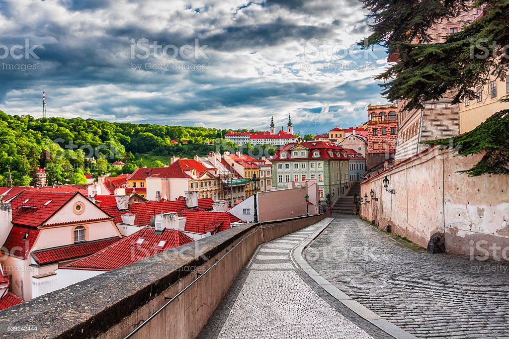Old town street and buildings, Strahov Monastery in the background royalty-free stock photo