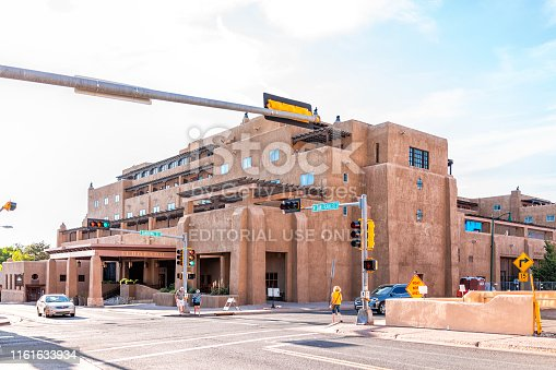 Santa Fe, USA - June 14, 2019: Old town street and Eldorado hotel in United States New Mexico city with adobe style architecture