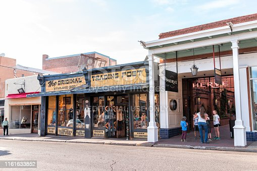 Santa Fe, USA - June 14, 2019: Old town street and trading post in United States New Mexico city with old architecture