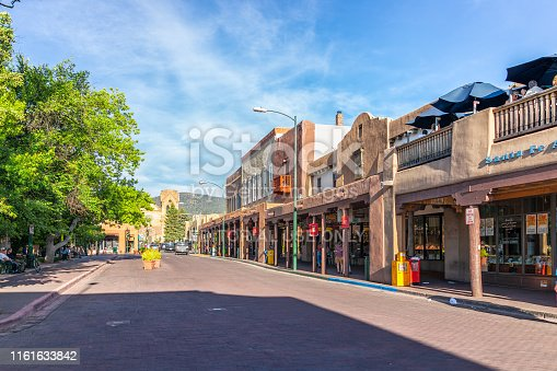 Santa Fe, USA - June 14, 2019: Old town street in United States New Mexico city with adobe style architecture and church