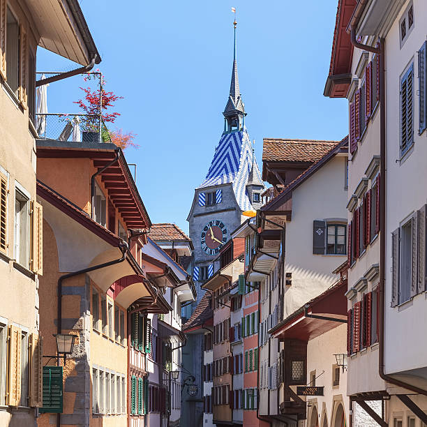 Old town street in Zug city Zug, Switzerland - 07 June, 2014: old town street. Zug is a German-speaking city in Switzerland, which is located in the Canton of Zug and is its capital. zug stock pictures, royalty-free photos & images