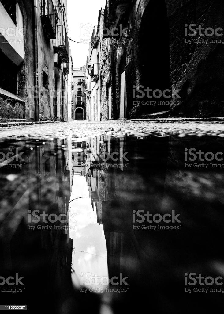 Old town street reflection - Tarragona, Spain stock photo