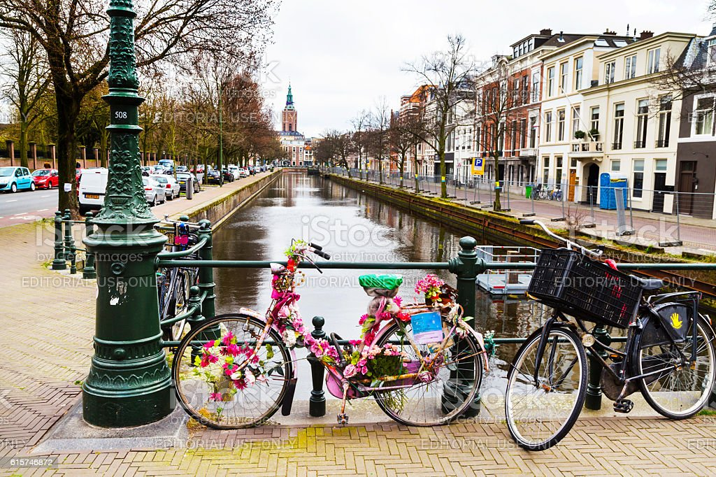 Old town street view with bike and flowers stock photo