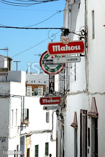 Row of bar signs on walls along a street in the old town, Conil de la Frontera, Cadiz Province, Andalusia, Spain, Europe.