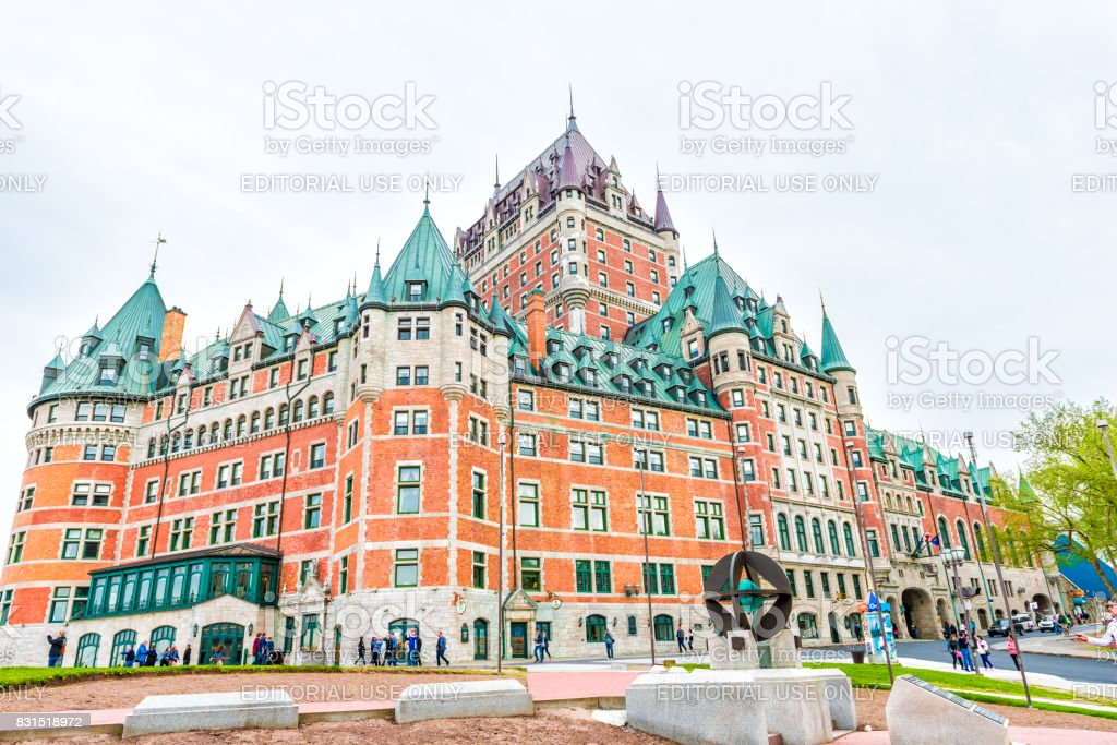 Old town street with view of hotel Chateau Frontenac with people walking stock photo