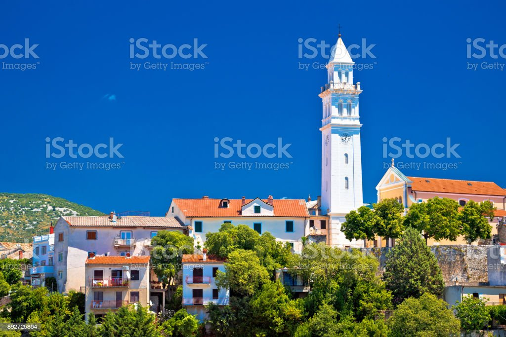 Old town tower and architecture of Novi Vinodolski, Kvarner bay of Croatia stock photo