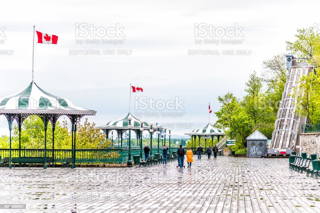 Old town view of Dufferin Terrace wooden boardwalk with benches, gazebo and people walking stock photo