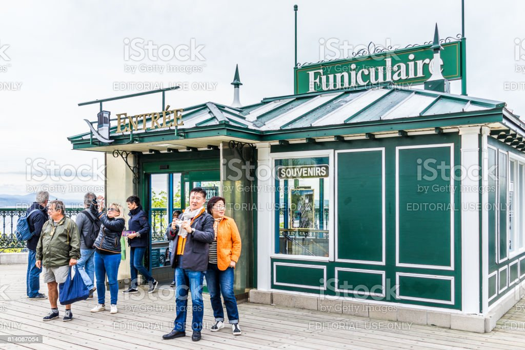 Old town view of Dufferin Terrace wooden boardwalk with Funiculaire building and souvenirs with happy people stock photo