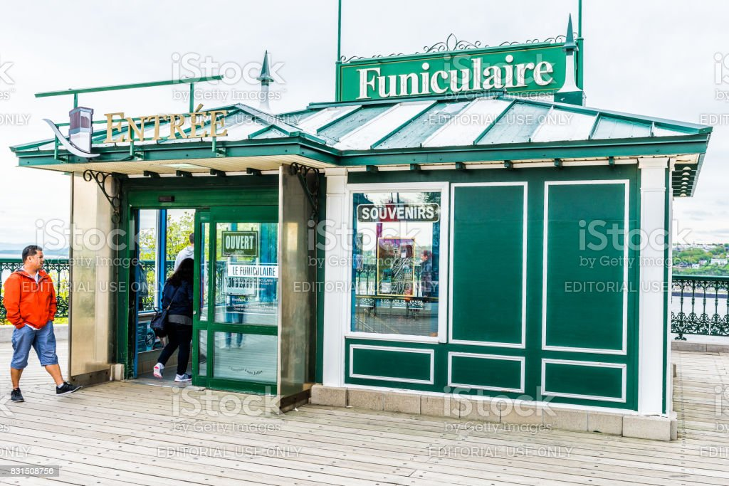 Old town view of Funiculaire Frontenac building entrance with people walking stock photo