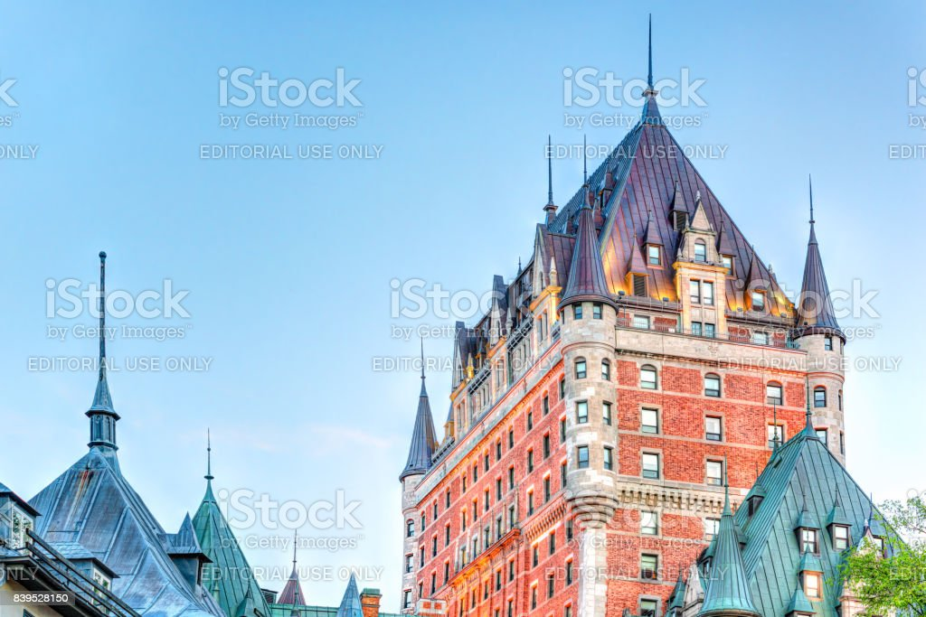 Old town view of hotel Fairfmont Chateau Frontenac brick castle building with blue evening sky stock photo