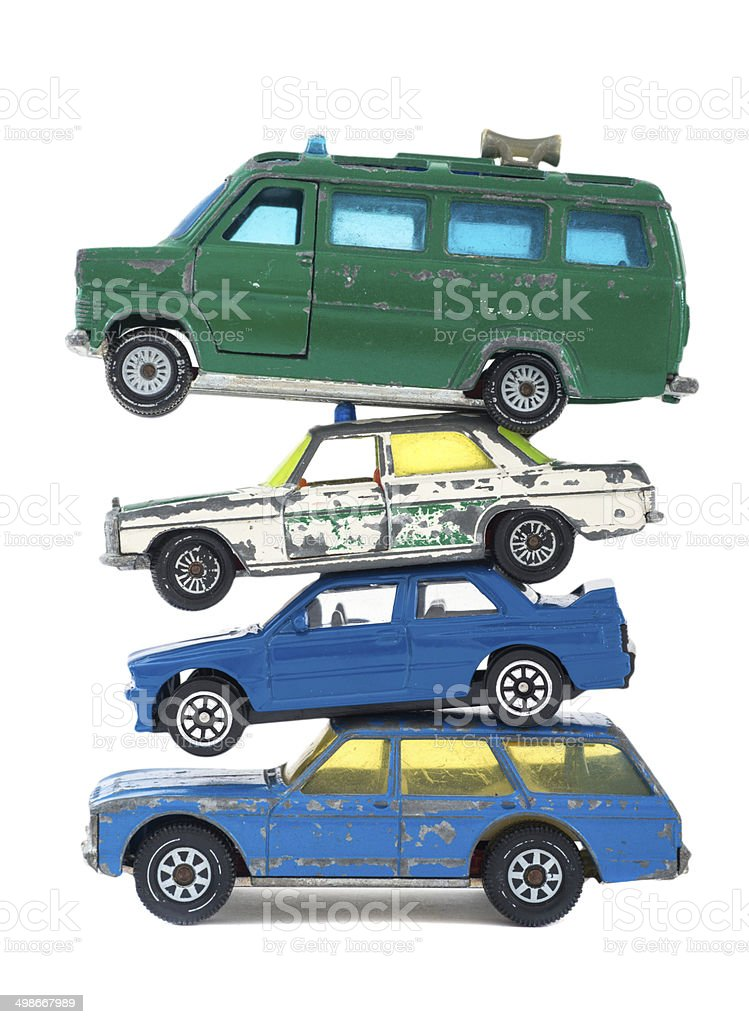 old toy cars pile stock photo