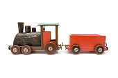 Used wooden toy train isolated on a white background.