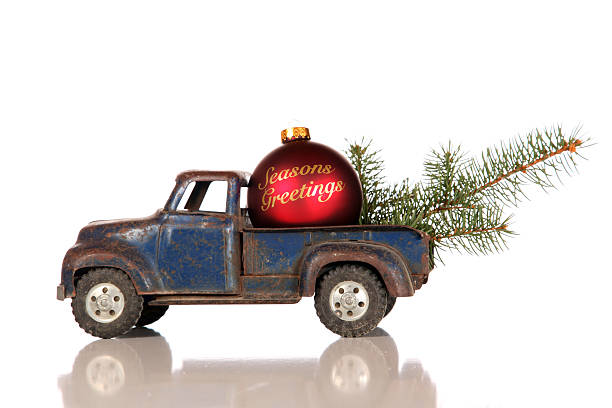 Old Toy Truck With Seasons Greeting Christmas Bauble stock photo