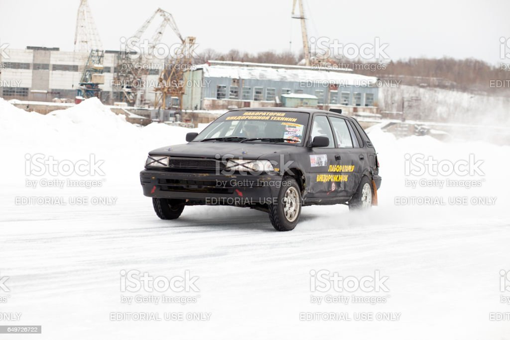 Old Toyota Corolla at winter ice track race on frozen river stock photo