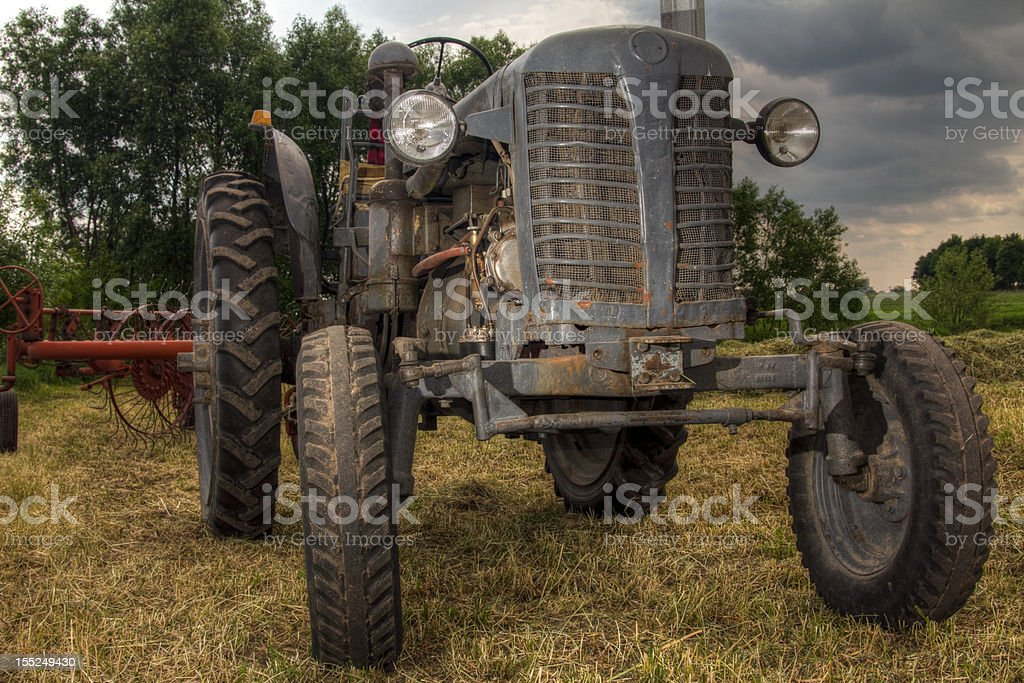 Old tractor working in the field royalty-free stock photo