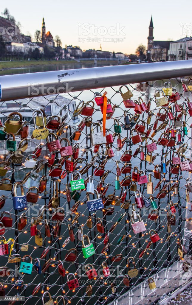 Old tradition of sealing a couple's initial names inscribed padlock with the popular bridge and tossing the key into the river to symbolize their eternal love. Makartsteg footbridge or Makartsteg Brucke, Salzburg, Austria, Europe. stock photo