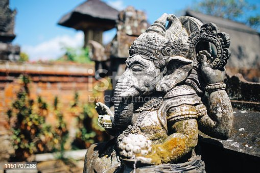 Traditional Balinese Hindu demon guardians stone sculptures near the famous Monkey Forest in Ubud, Bali, Indonesia.