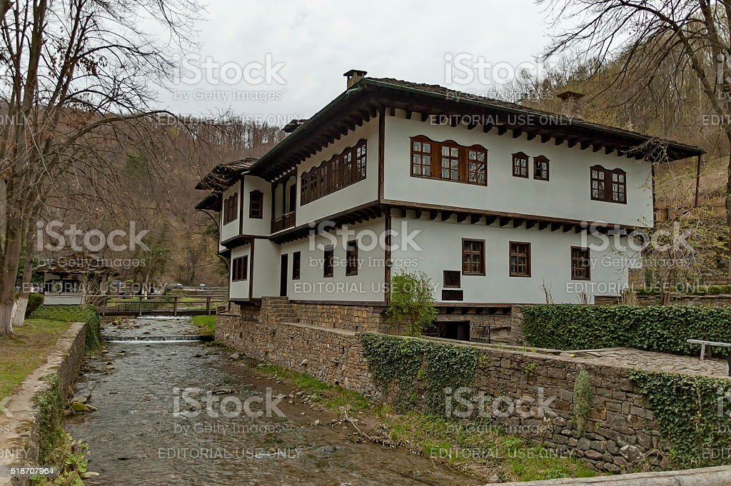 Old traditional houses and river with bridge in Etar, Gabrovo stock photo