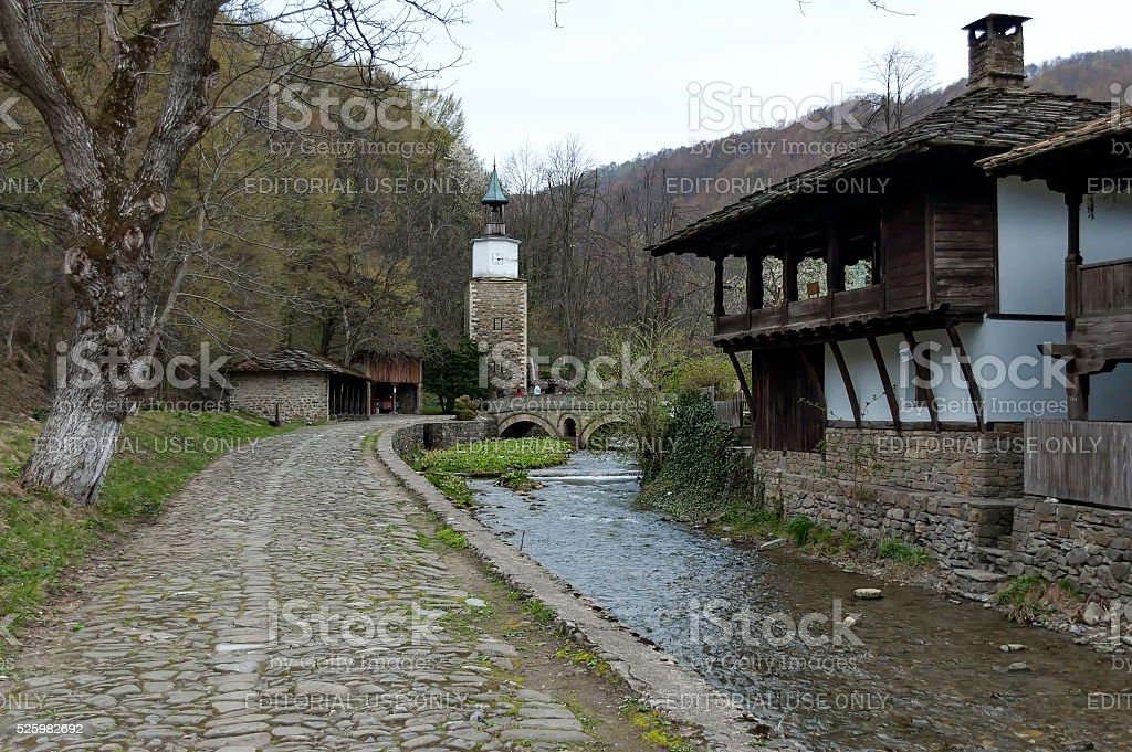 Old traditional houses, traditional clock tower  and river stock photo