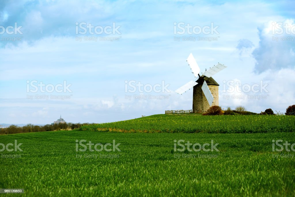 old traditional normandian windmill at the field zbiór zdjęć royalty-free