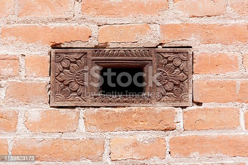 Old traditional wooden window a in small village in Nepal