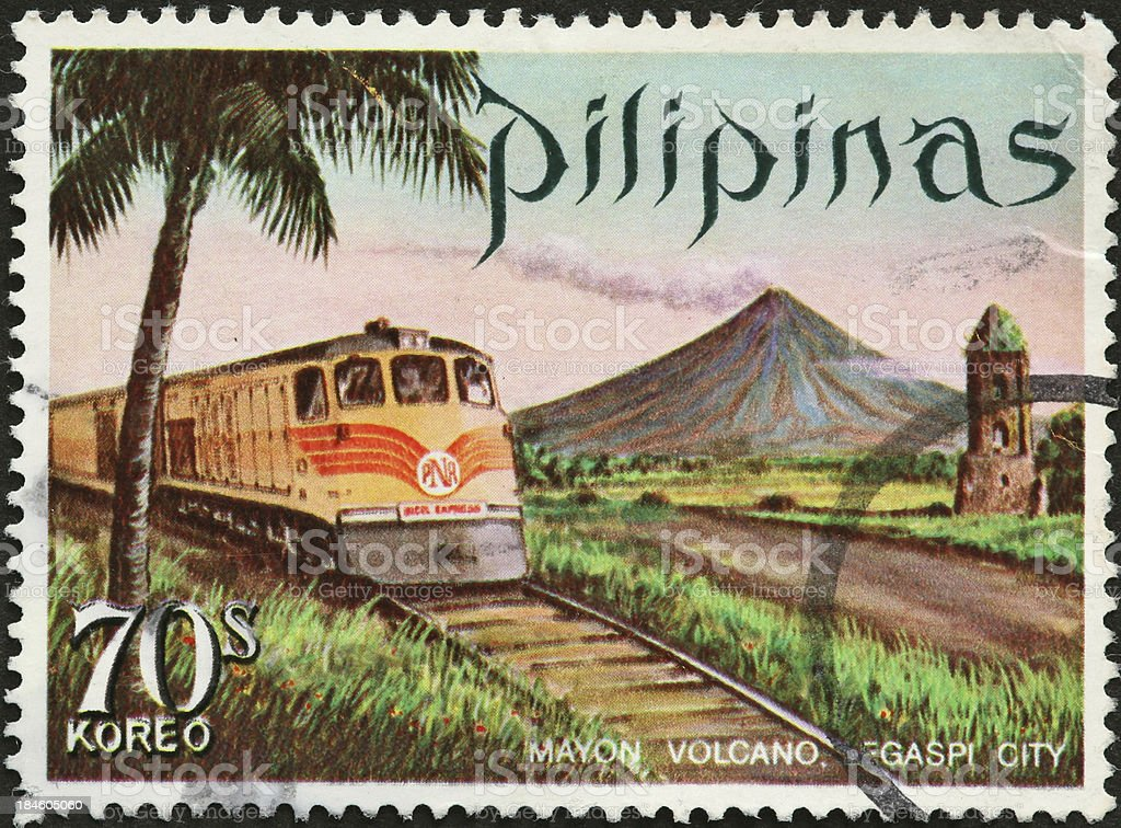 old train and volcano on a Philippine postage stamp stock photo