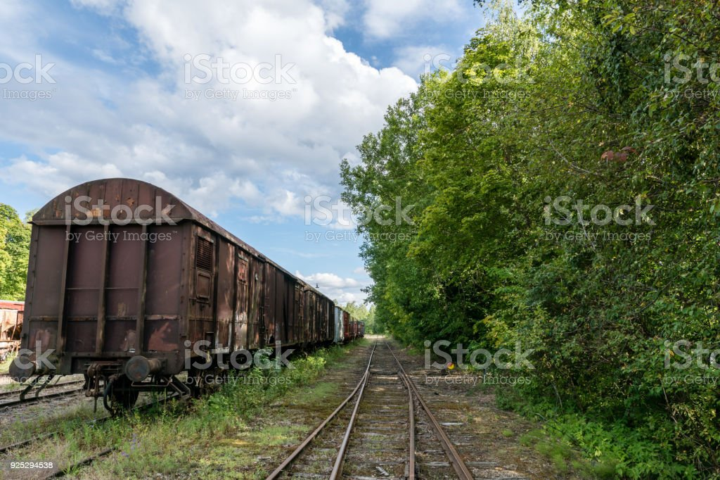 Old train set standing on an old railroad track in Sweden stock photo