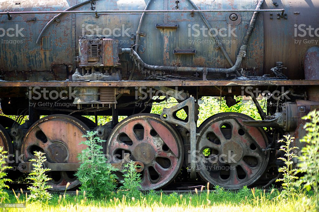 old train stopping in weeds stock photo