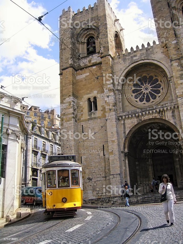 Old tram and Se Cathedral in Alfama (Lisbon - Portugal) stock photo