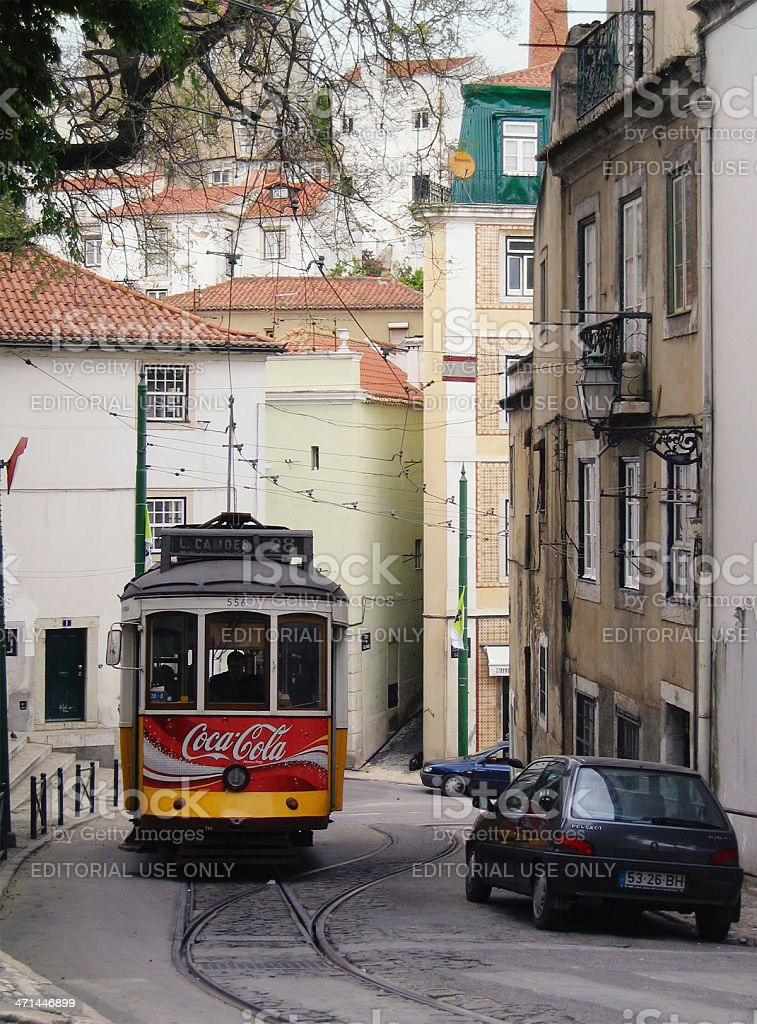 Old tram in Alfama (Lisbon - Portugal) stock photo