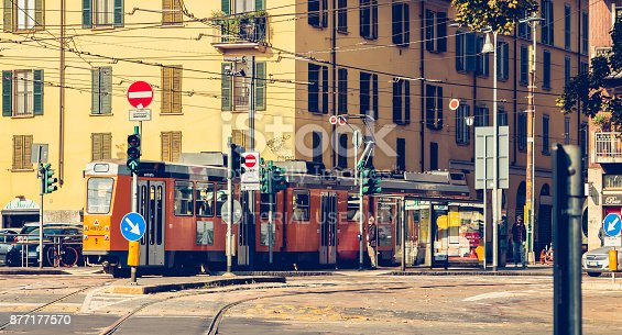 Milan: an old tram of line 12 of the public company Azienda Transport Milanesi stopped in a station